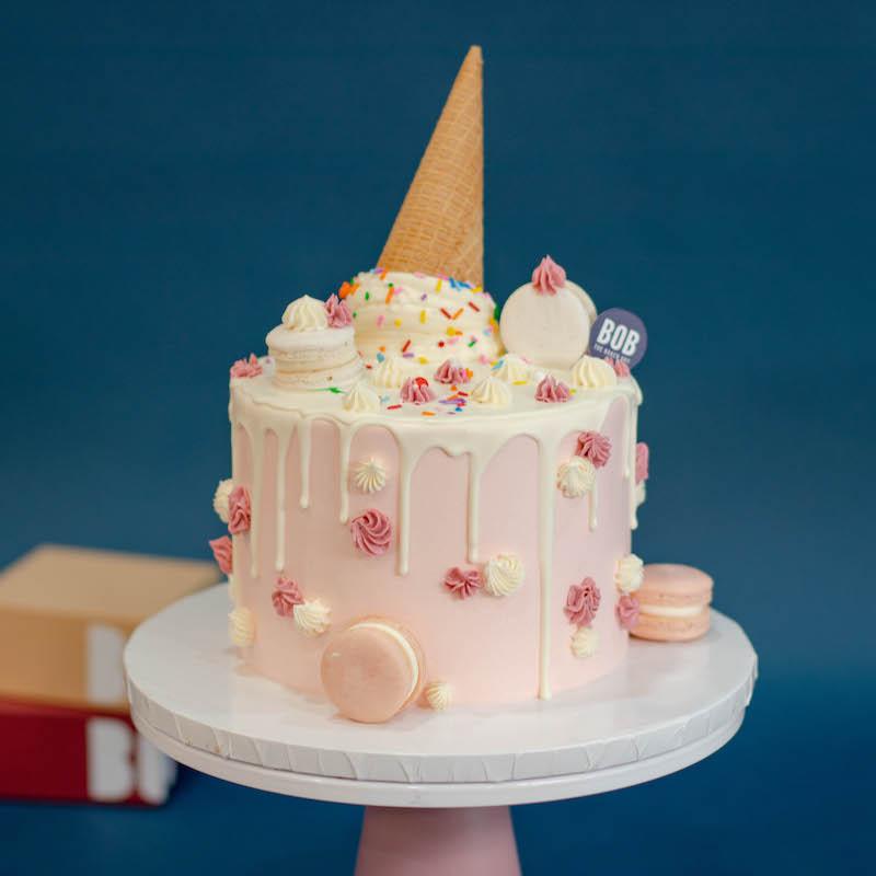 Whimsical Pastel Pink Candyland Cake