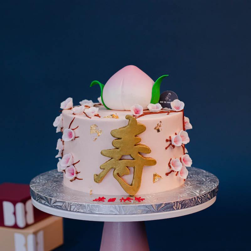 Pastel Pink Longevity Cake with 1 Large Shou Tao