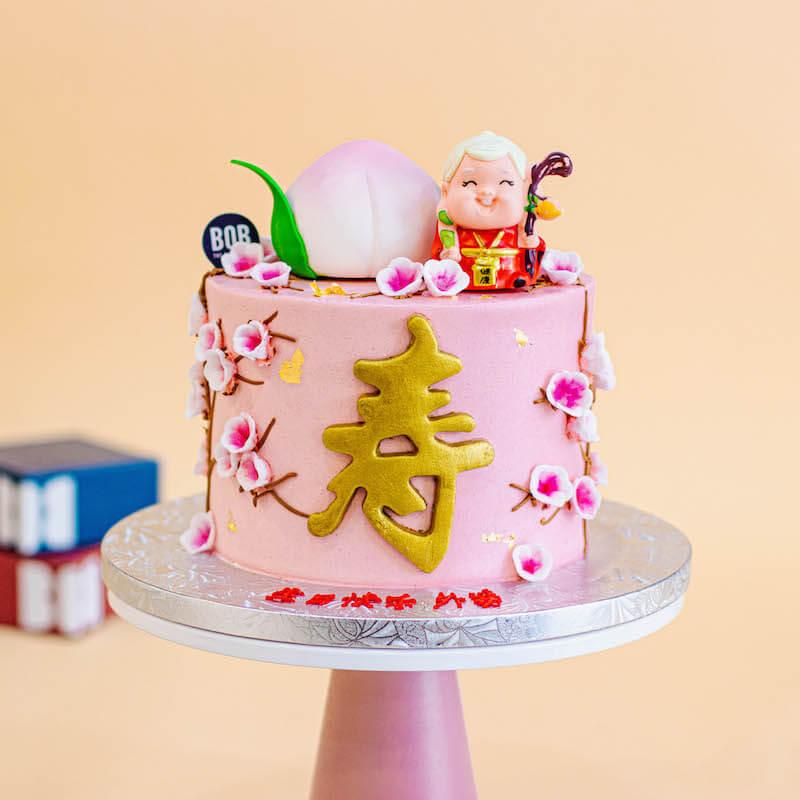 Pastel Pink Longevity Cake with Grandma