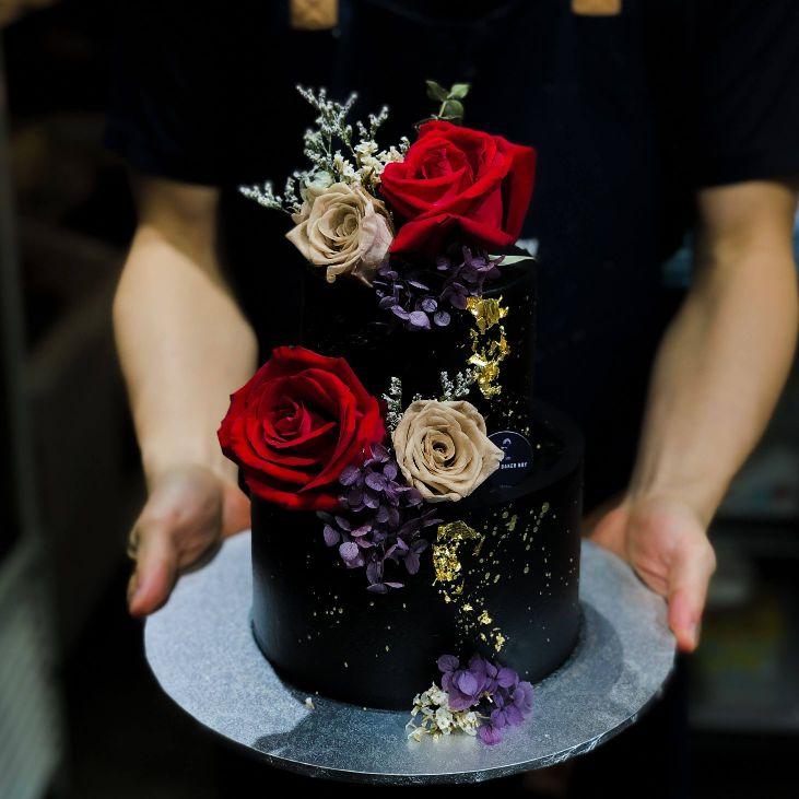 Black Splash Cake with Burgundy Florals